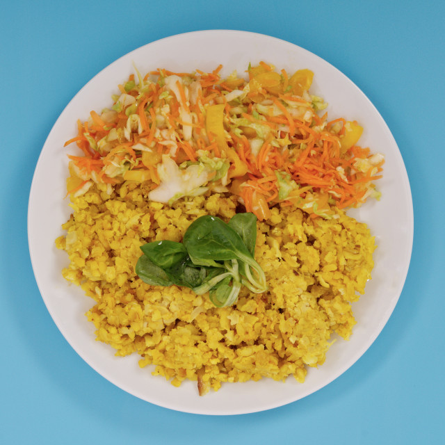 """""""Baked Bulgar with cauliflower and vegetable salad on a blue"""" stock image"""