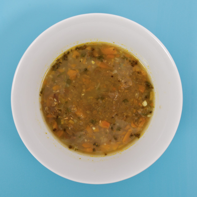 """Lentil soup with carrot on a blue"" stock image"