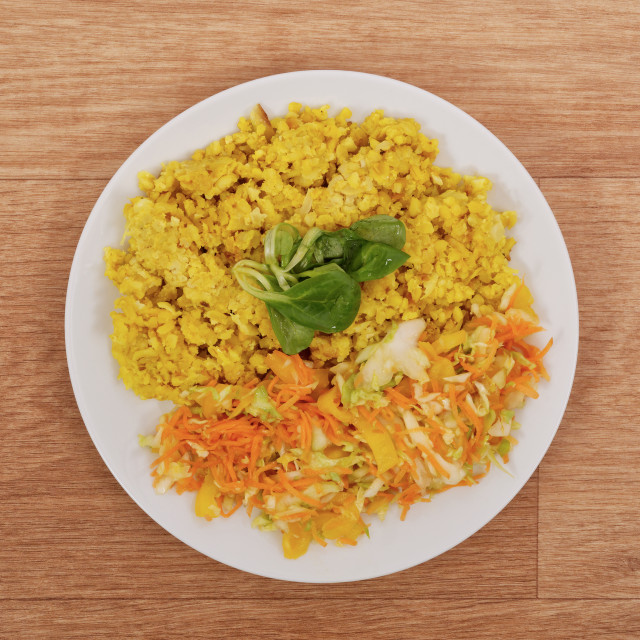 """""""Baked Bulgar with cauliflower and vegetable salad on a table"""" stock image"""