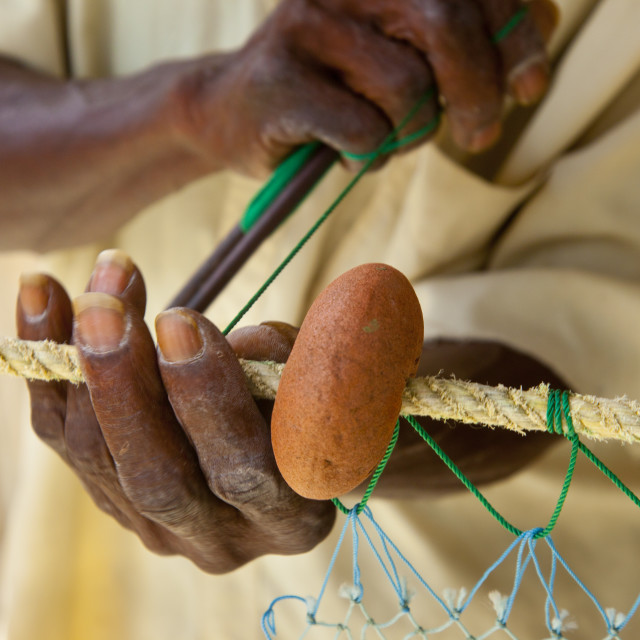 """Weathered hands of old fisherman mending nets in Canaries, St. Lucia, West..."" stock image"
