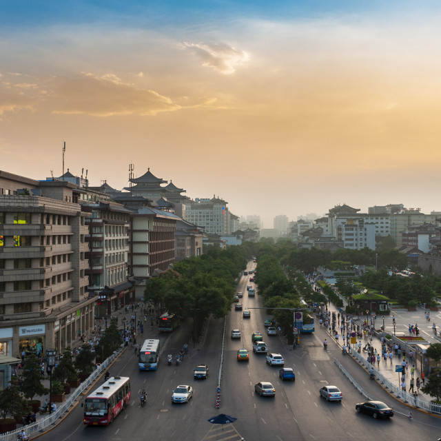 """Xian, China - August 6, 2012: Street scene in the city of Xian at sunset, with an avenue and a cars, in China, Asia"" stock image"