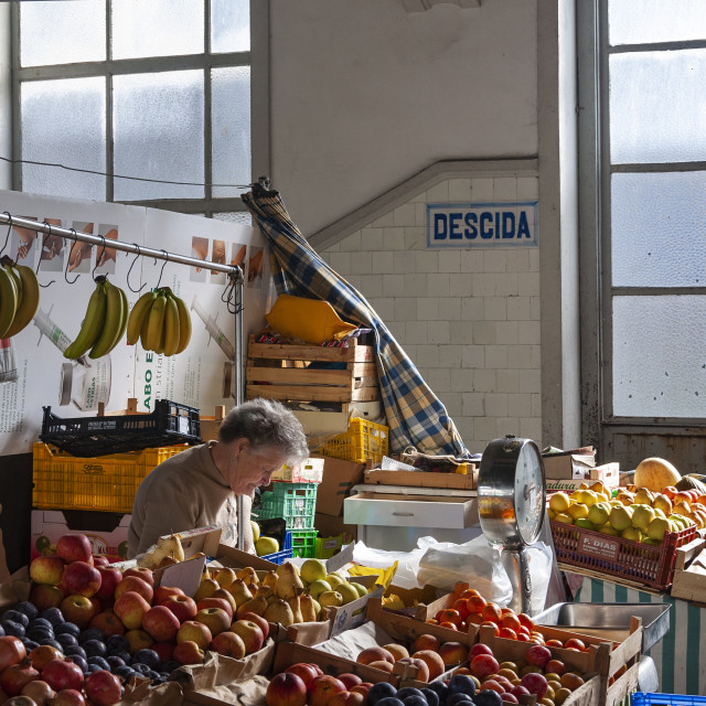 """Porto, Portugal - October 4, 2010: Vendor at the traditional Bulhao Market (Mercado do Bolhao) in the city of Porto, Portugal"" stock image"