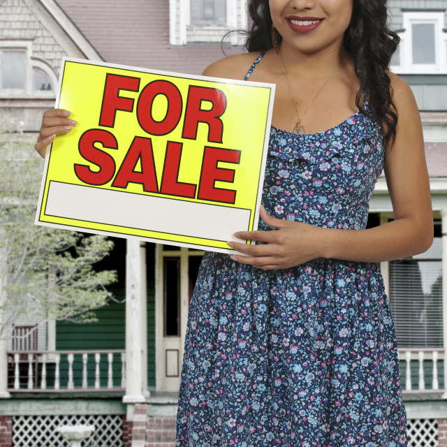 """Woman holding for sale sign"" stock image"