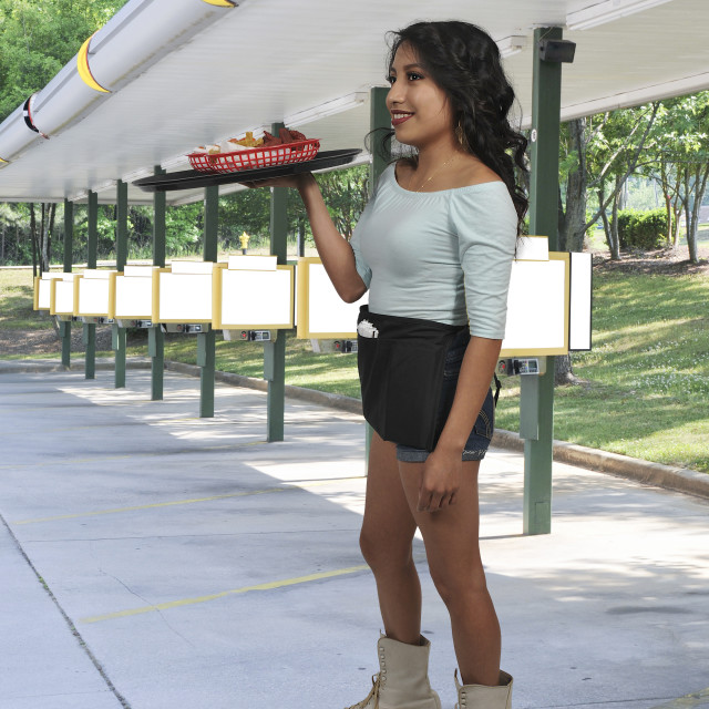 """Woman server or waitress on roller skates"" stock image"