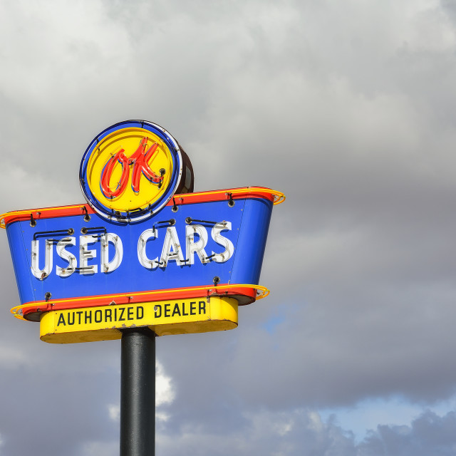 """OK Used Cars neon sign."" stock image"