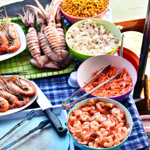 """Preparing seafood in the street restaurant on boat in Thailand"" stock image"