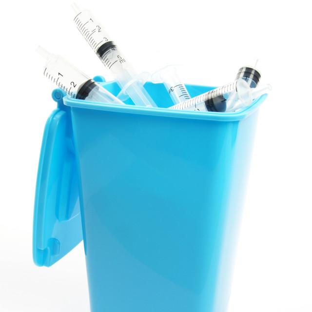 """medical syringes inside a blue rubbish bin"" stock image"