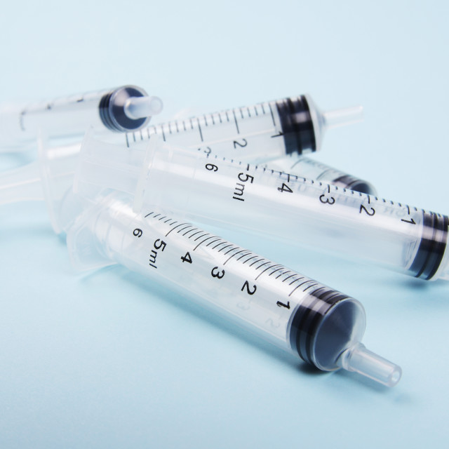 """stack of clear medical syringes"" stock image"
