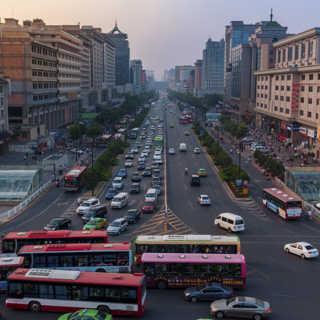 """Xian, China - August 6, 2012: Street scene in the city of Xian at sunset, with an avenue and a traffic jam, in China, Asia"" stock image"
