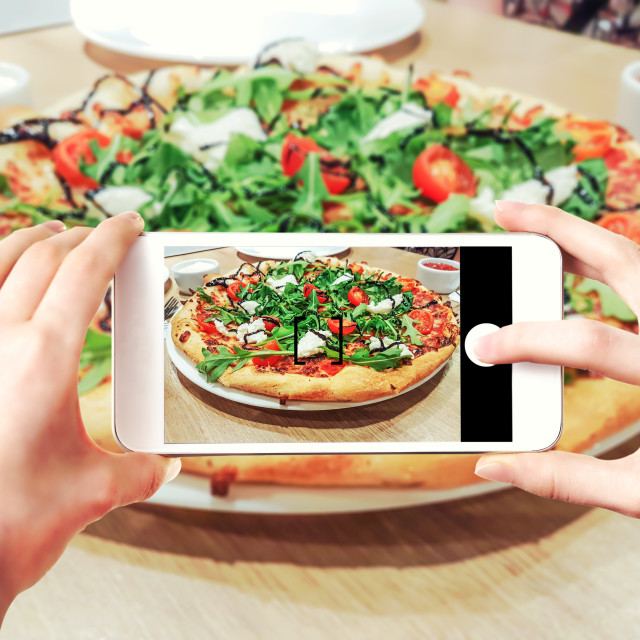 """""""Making pizza photos on smartphone"""" stock image"""