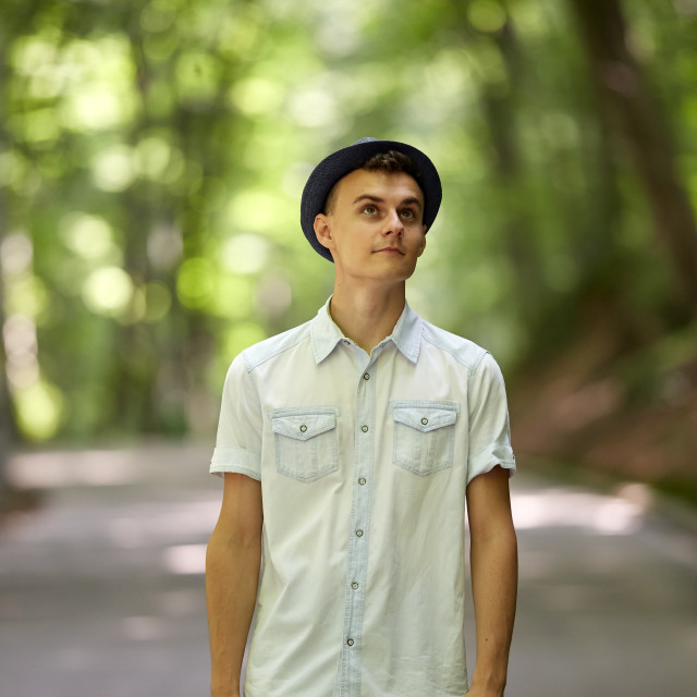 """Handsome teenager in the park"" stock image"
