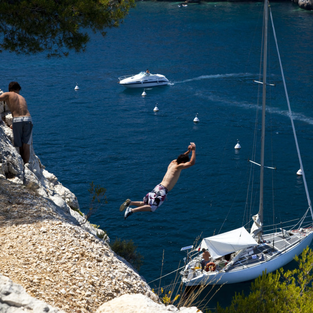 """""""Jumping off cliffs in the Calanques near Cassis, Provence France"""" stock image"""