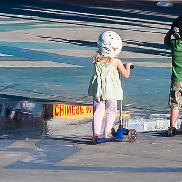 """Children on scooters"" stock image"