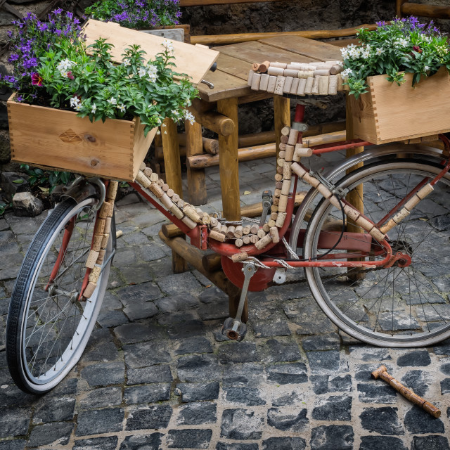 """Bicycle decorated with corks and flowers"" stock image"