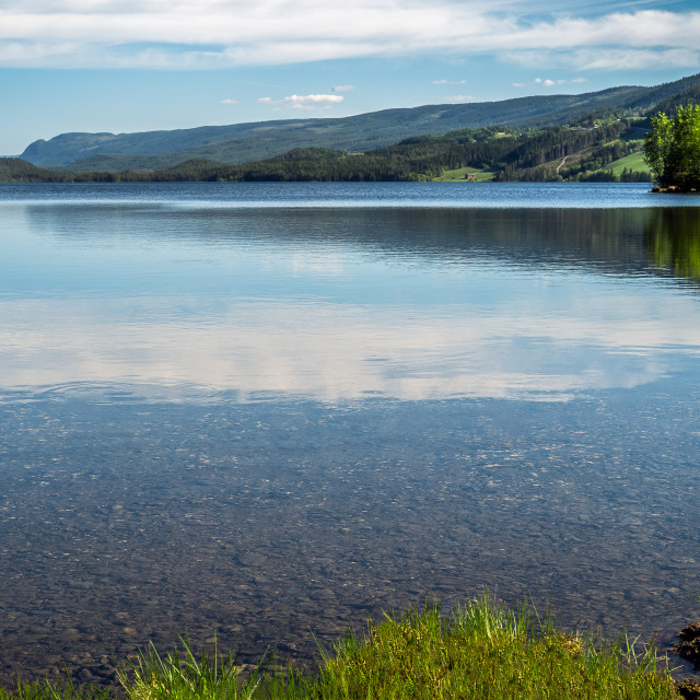 """Beautiful scenic view of quiet lake and rural mountains from Valdres, Norway"" stock image"