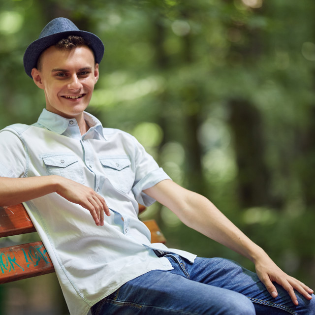 """Happy young man in the park"" stock image"