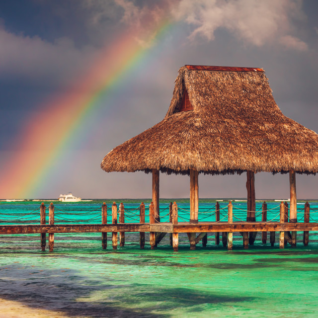 """""""Rainbow over the Tropical beach in Punta Cana, Dominican Republi"""" stock image"""