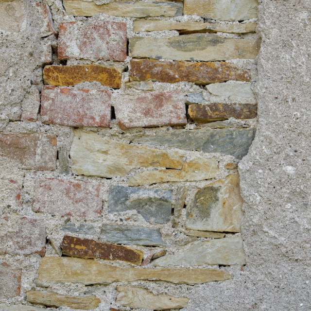 """Old vintage brick and stone wall with crashed white plaster texture"" stock image"