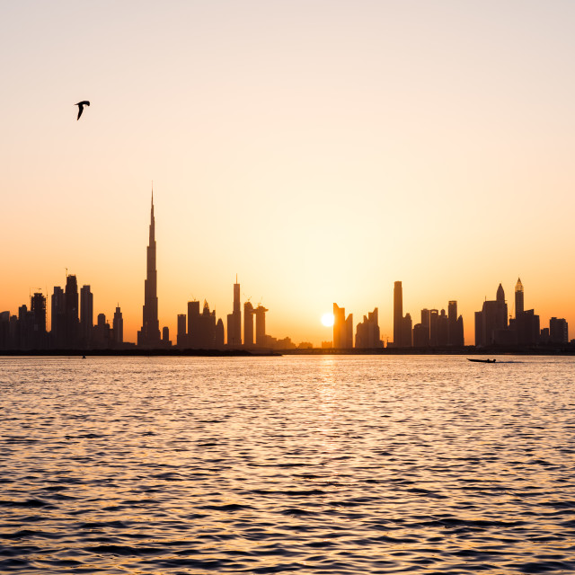 """Panoramic view of Dubai cityscape at sunset"" stock image"