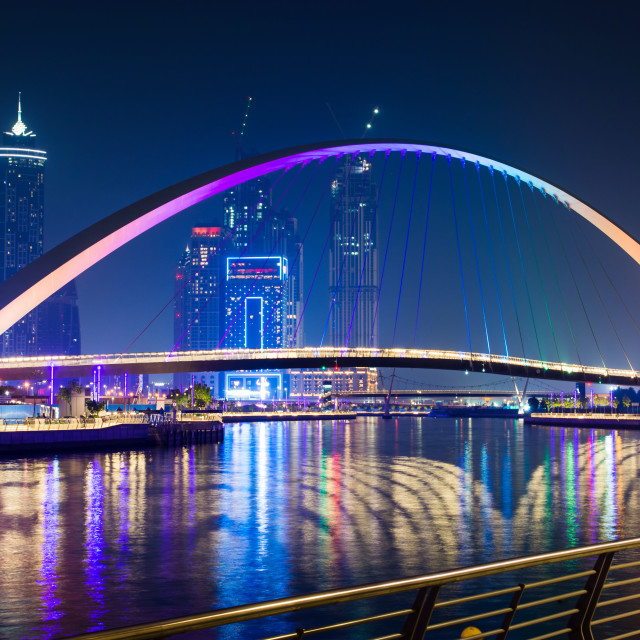 """Dubai water canal bridge at night"" stock image"
