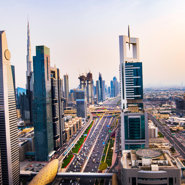 """Modern skyscrapers of downtown Dubai from a rooftop at sunset"" stock image"