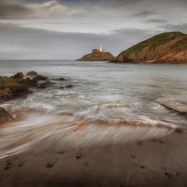 """Mumbles Lighthouse and beach"" stock image"