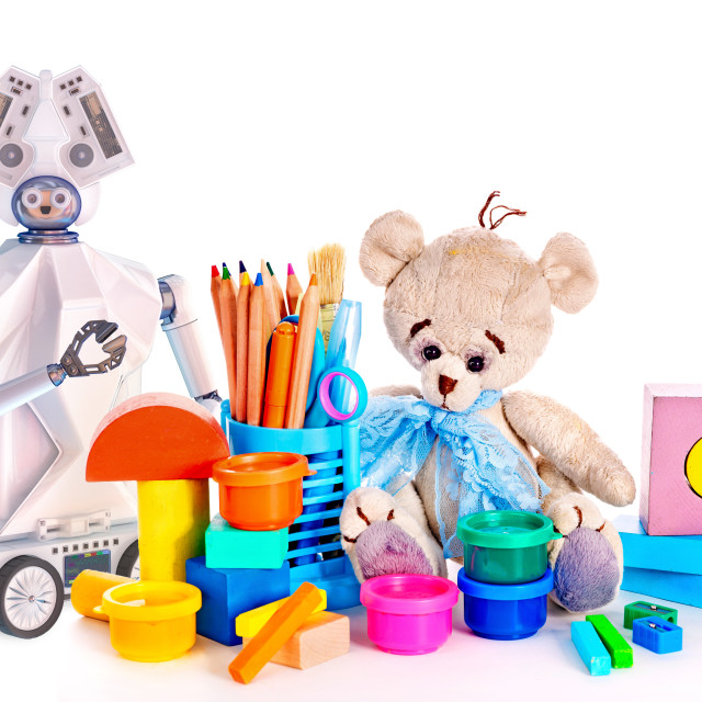 """""""Robot toy and stuffed animals teddy bear and color pencils and cans of paint."""" stock image"""