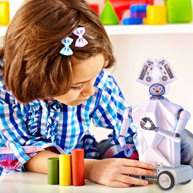 """""""Child build robot toy. Kid engaged robotics in programming classes."""" stock image"""
