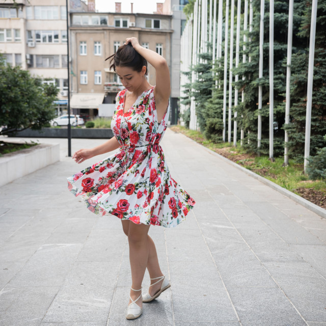 """young woman in colorful dress dancing on street"" stock image"