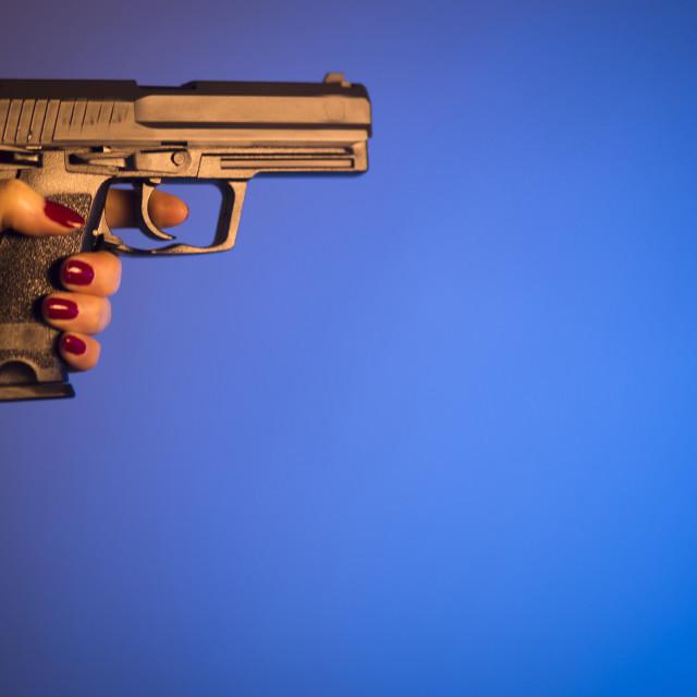 """Woman hand holding pistol"" stock image"