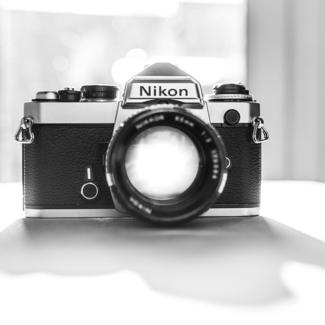 """Nikon FE single lens reflex 35mm film camera"" stock image"