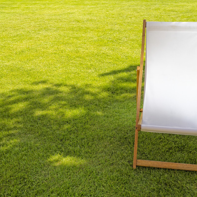 """Single White Empty Deck Chair"" stock image"