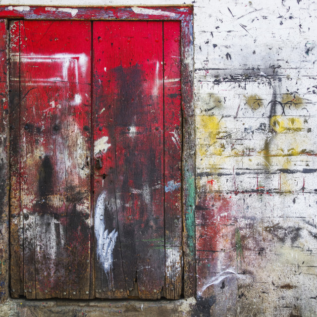 """""""Red wooden doors and wall splattered with multiple paint colours; Nicaragua"""" stock image"""