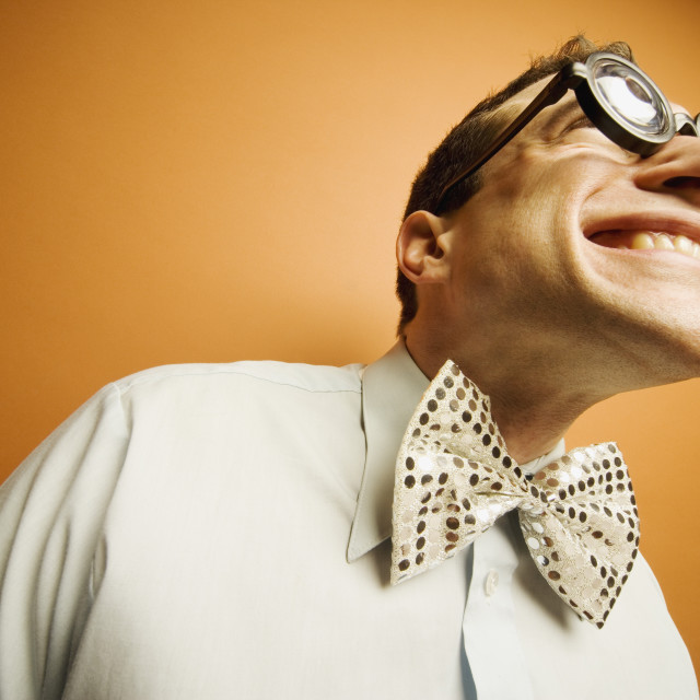 """Man Wearing Thick Glasses And A Bow Tie"" stock image"