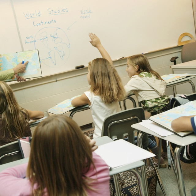 """Elementary Classroom With Teacher And Students"" stock image"