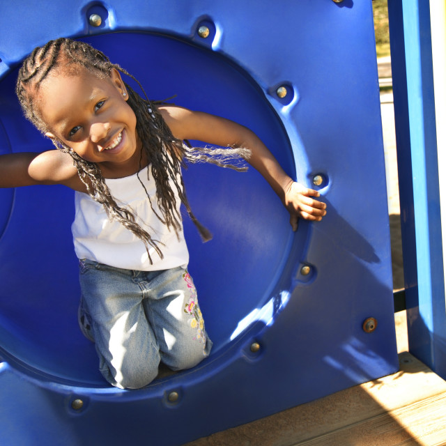 """Little Girl Playing On Park Equipment"" stock image"