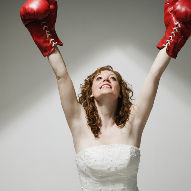 """Bride Cheering In Boxing Gloves"" stock image"