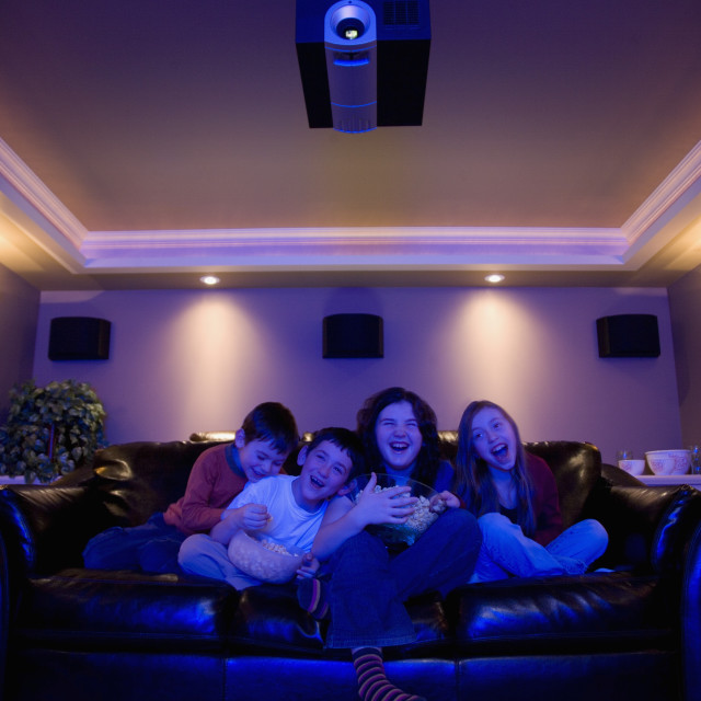 """Kids Watching A Movie"" stock image"
