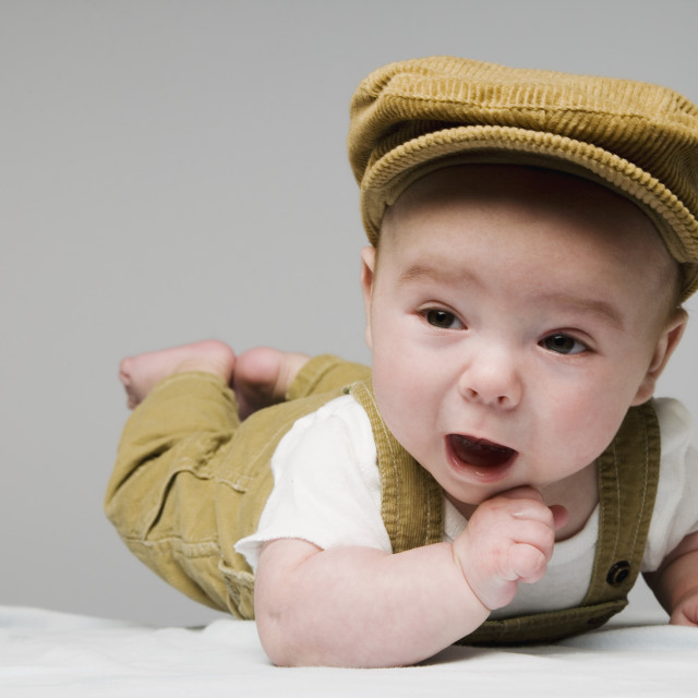 """Baby On Belly With Hat And Overalls"" stock image"