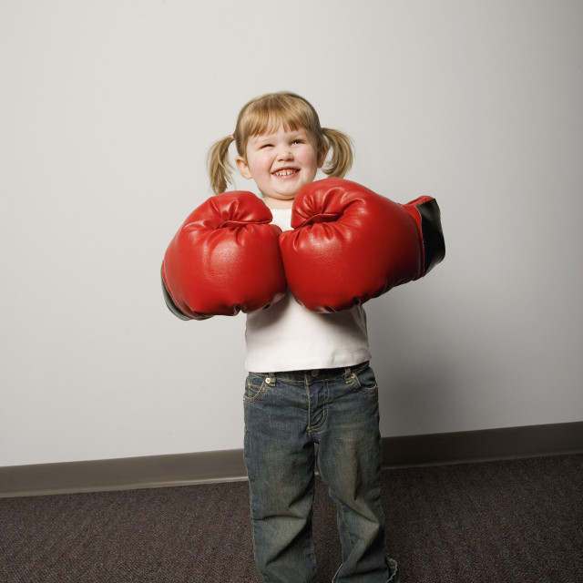"""Little Girl With Boxing Gloves"" stock image"