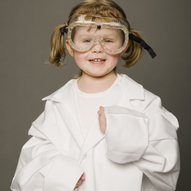 """Little Girl In White Coat And Safety Goggles"" stock image"