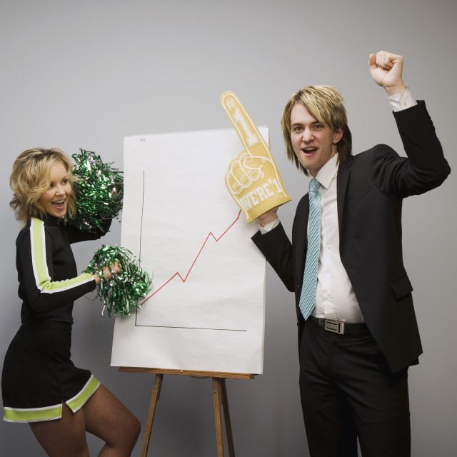 """Cheerleader And Businessman Cheering"" stock image"