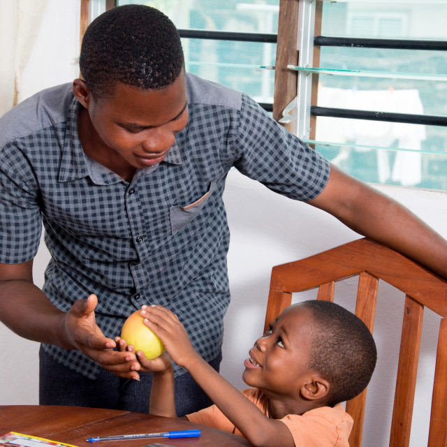 """""""Child showing an apple to his father."""" stock image"""