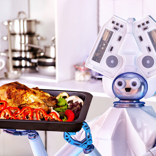 """Robot domestic assistance cook at kitchen."" stock image"
