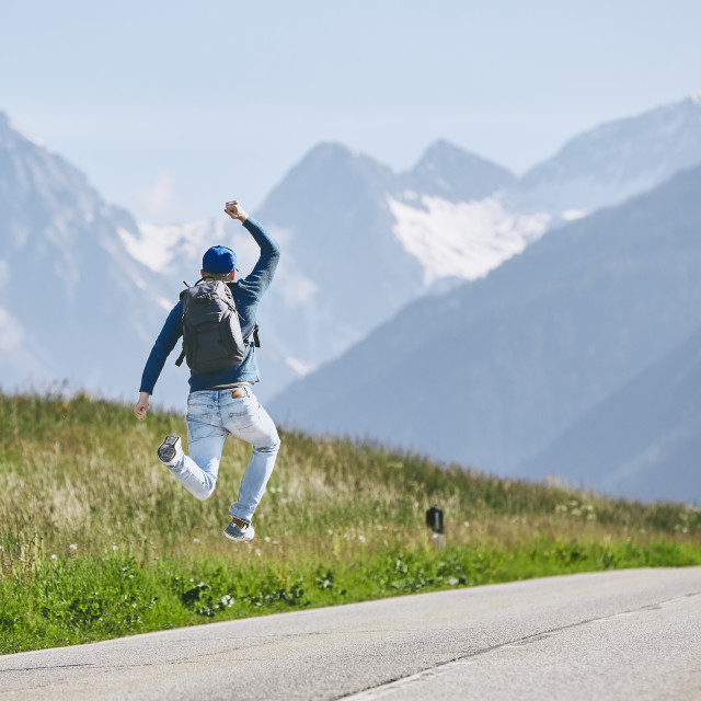 """""""Happy traveler in mountains"""" stock image"""