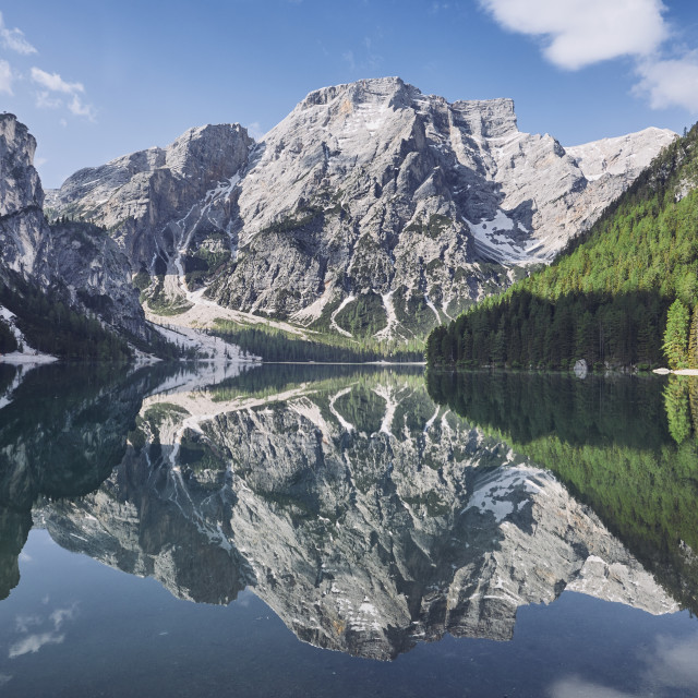 """Reflection of the mountain in the water"" stock image"