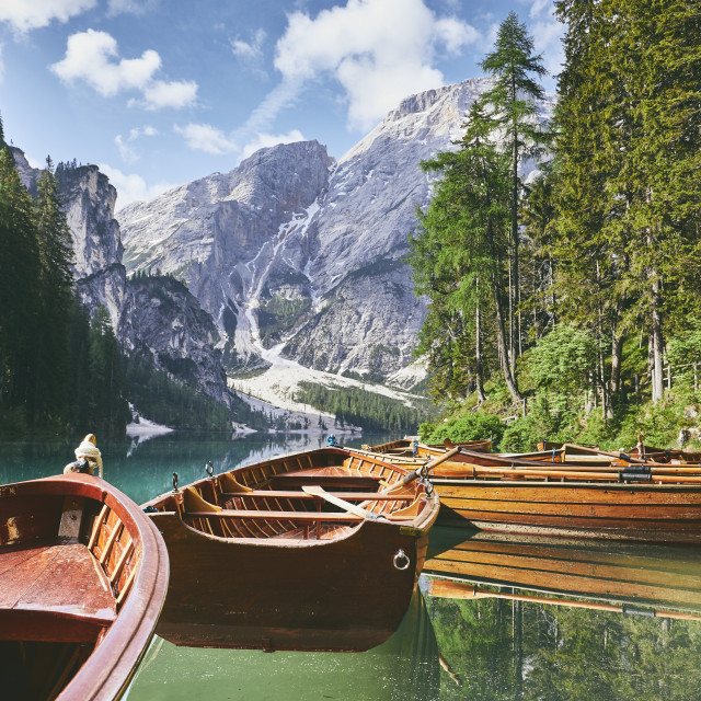 """Wooden boats on lake"" stock image"