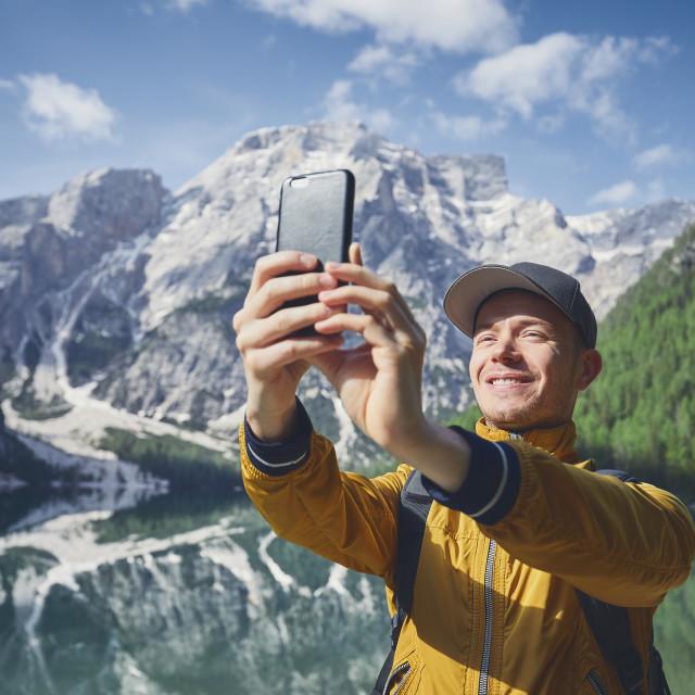 """Tourist taking selfie"" stock image"