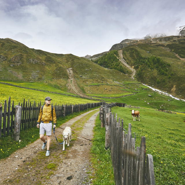 """""""Tourist with dog in countryside"""" stock image"""