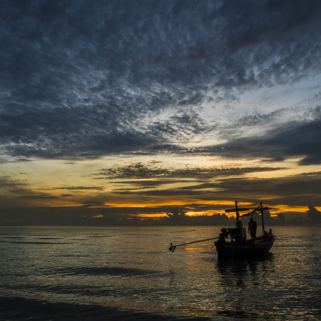 """A beautiful tropical dawn with a fishing boat"" stock image"